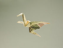 Bird origami out of the money Stock Photo