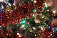 Bird ornament in lighted tree Stock Photography