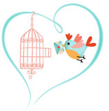 Bird out of the cage holding a love letter Stock Photo