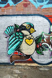 A bird painted on a brick wall. vector illustration