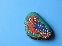 Bird painted on stone Stock Images