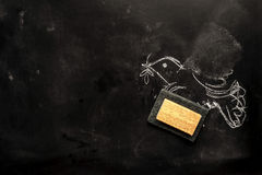 Bird partially wiped out. Chalk board with drawn dove partially wiped out� concept of peace and war Stock Photo