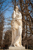 Bird perched on an ancient stone statue Royalty Free Stock Photography