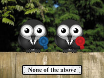 Bird Politicians. Comical bird politicians with none of the above sign perched on a timber garden fence against a foliage background Royalty Free Stock Image