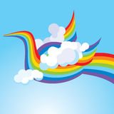 Bird from a rainbow in the sky Royalty Free Stock Photography
