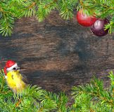 Bird in red santa hat, christmas tree branches, baubles frame. Christmas card. Watercolor royalty free stock images