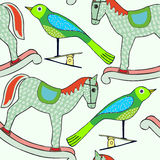 Bird and rocking horse  illustration, hand-drawn Christmas Theme, wallpaper wrapping paper background Royalty Free Stock Photos