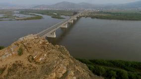 A bird's-eye bridge over the Selenga River, Ulan-Ude, Buryatia, Russia stock video footage