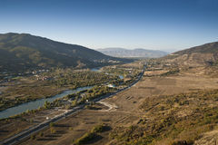 Bird's eye panorama of a Caucasus. Bird's eye panorama with river, road, and the Caucasus mountans royalty free stock photos
