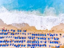 Bird's-eye view of a beach with big waves, sunbeds and umbrellas. In Lefkada, Greece royalty free stock image