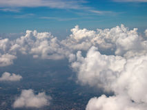 Bird's-eye view of blue sky clouds. With Background city, Thailand Stock Photos