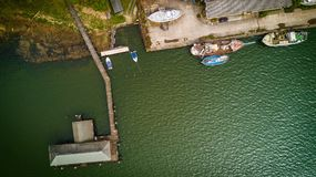 Bird's Eye View of Boat Near Dock on Calm Body of Water Stock Images