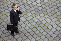 Bird's-eye view of a businesswoman in the street on the phone Stock Image