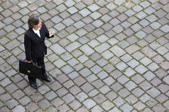 Bird's-eye view of a businesswoman in the street Royalty Free Stock Image