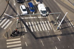 Bird`s eye view of cars crossing intersection with people walking on crosswalk on March 3, 2017 in Prague, Czech republic Stock Images