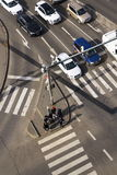 Bird`s eye view of cars crossing intersection with people walking on crosswalk on March 3, 2017 in Prague, Czech republic Royalty Free Stock Photo
