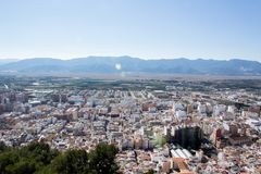 Bird`s eye view of the city with mountains stock photography