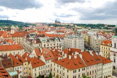 Bird`s eye view of the city of Prague with overcast sky seen from the Old Town Hall Tower, also known as the Clock Tower.  Royalty Free Stock Photos