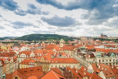 Bird`s eye view of the city of Prague with overcast sky seen from the Old Town Hall Tower, also known as the Clock Tower.  Stock Image