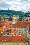 Bird`s eye view of the city of Prague with overcast sky seen from the Old Town Hall Tower, also known as the Clock Tower.  Stock Photos