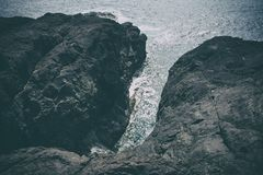Bird's Eye View of Cliff over Cove Royalty Free Stock Image