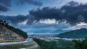 Bird`s eye view at coastal town at twilight. 4k time lapse. Bird`s Eye View at Coastal Town at Twilight. Landscape of Dusk Above the Turkish City Marmaris With stock video footage