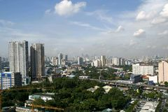 Bird's eye view of the commercial and residential buildings. QUEZON CITY, PHILIPPINES - JULY 21, 2016: A bird's eye view of the commercial and residential Royalty Free Stock Photography