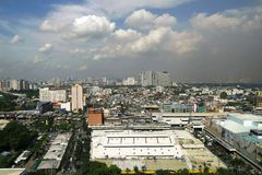 Bird's eye view of the commercial and residential buildings. QUEZON CITY, PHILIPPINES - JULY 21, 2016: A bird's eye view of the commercial and residential Royalty Free Stock Images
