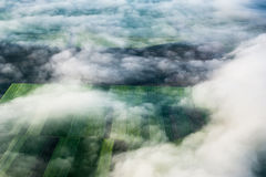 Birds eye view of the earth. Above the clouds, birds eye view of the fields and agricultural parcel Royalty Free Stock Images
