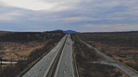 Bird eye view from flying drone of traveler walking around beautiful In Ukraine along terrain road. Bird`s eye view from flying drone of traveler walking around stock video footage