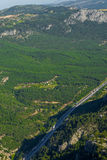 Bird`s-eye view of forest, village and highway Stock Photo