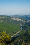 Bird`s-eye view of forest, village and highway royalty free stock image