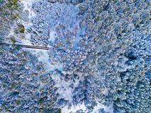 A bird`s eye view of a forest and a winter journey snow-covered by the drone Stock Image