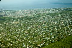 Bird`s-eye view of Georgetown city, taken from an airplane. Guyana. Landscape city of South America stock photo