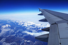 Birds eye view of Glacier under the plane wing Royalty Free Stock Photo