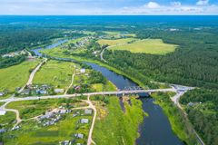 Bird`s eye view of the green forests, river and the village. Karelia. Royalty Free Stock Images
