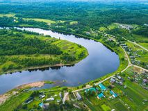 Bird`s eye view of the green forests, river and the village. Karelia Royalty Free Stock Image