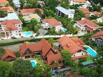 Bird's eye view of high class landed property estate with large beautiful houses and many private swimming pools Stock Photo