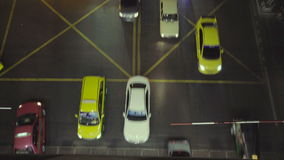 Bird's eye view looking down on top of traffic jam in busy Bangkok city at night. City traffic at night in slow motion, perspective view from top point. Bird's stock video footage