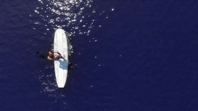 Bird`s Eye View of Man on Stand Up Paddleboard stock video footage