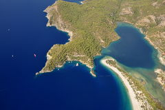A bird's-eye view of Mediterranean beach. Paraglide at Oludeniz beach of Fethiye in Turkey, have a bird's-eye view of Mediterranean sea stock photography