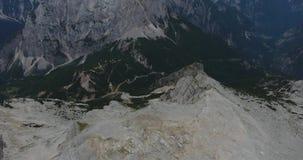 Bird`s eye view of mountain ridge with view raising towards sunrise. stock video footage