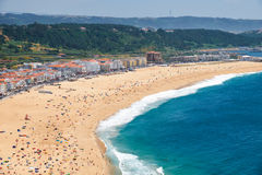Bird`s-eye view on Nazare beach riviera on the coast of Atlantic Stock Images