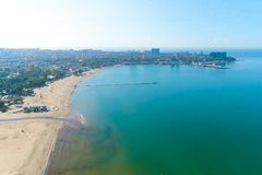 Free Bird`s Eye View Of The Sandy Beach, The Sea, The Seaside Coastal Town And The Pier. Stock Image - 131796721
