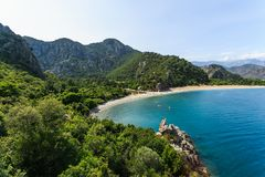 Beautiful Olympos beach in Turkey. Bird& x27;s eye view of Olympos beach in Turkey. Turquoise bay surrounded by mountains Royalty Free Stock Photo