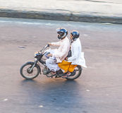Bird's eye view onto a couple on a motorbike in Jaipur Stock Photo