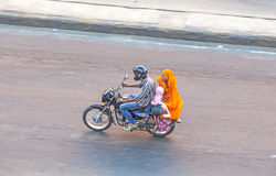 Bird's eye view onto a family on a motorbike in Jaipur Stock Images