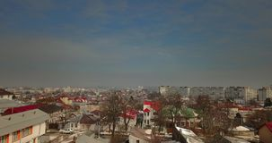 Aerial view of Romanian city in a overcast day. Bird`s eye view over Romanian city of Galati in spring with Danube river in the background stock footage