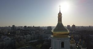 A bird`s eye view, panoramic video from the drone in 4K to the golden dome of the bell tower of Saint Sophia`s Cathedral. Aerial panoramic video from the drone stock video