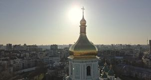 A bird`s eye view, panoramic video from the drone in 4K to the golden dome of the bell tower of Saint Sophia`s Cathedral. Aerial panoramic video from the drone stock footage